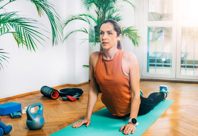 Home Exercising. Woman Stretching at Home